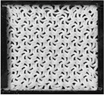 Complex Ordered Patterns in Mechanical Instability Induced Geometrically Frustrated Triangular Cellular Structures